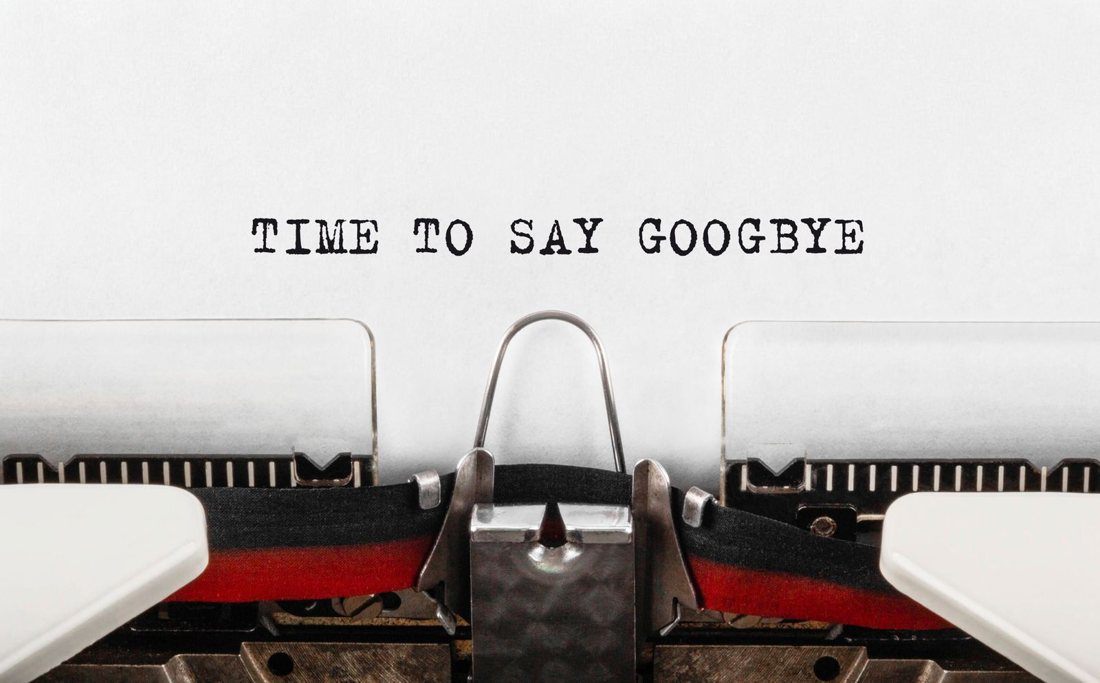 Text Time to Say Goodbye typed on typewriter