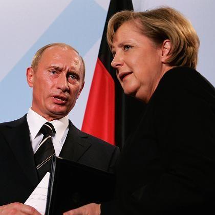 German Chancellor Angela Merkel and Russian President Vladimir Putin in Dresden on Tuesday.