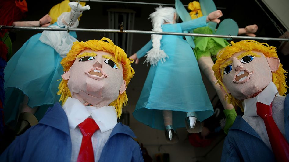 Poking fun at the über-oligarch: Donald Trump pinatas are displayed in the window of a store in San Francisco's Mission District.