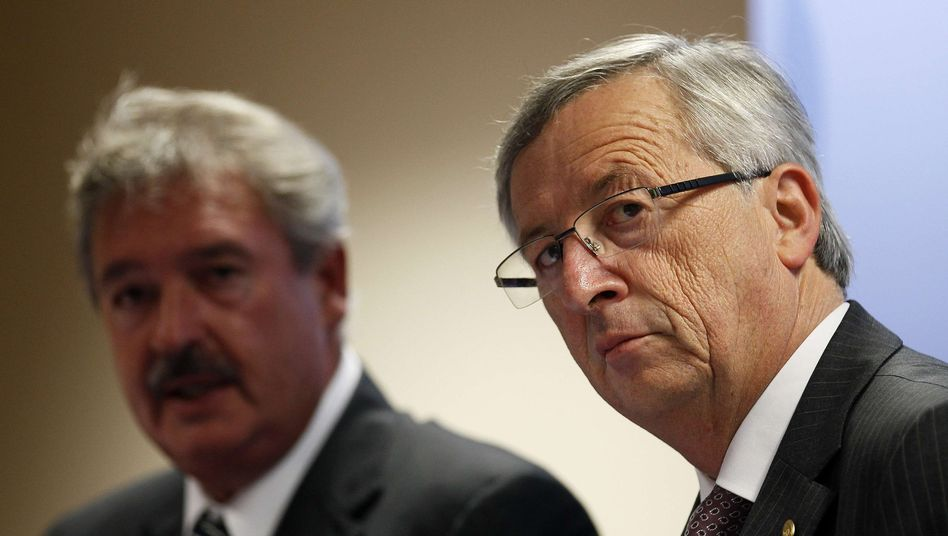 "Luxembourg's Prime Minister Jean-Claude Juncker (right): ""Helmut Kohl was good, and Merkel is not bad."""