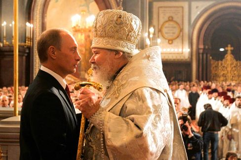 """Russian President Vladimir Putin faces Patriarch Alexy II during an Easter service in Moscow, 2006. """"I would like to see the president and the ministers go to church every Sunday and not just one or two times a year,"""" says Kyrill."""