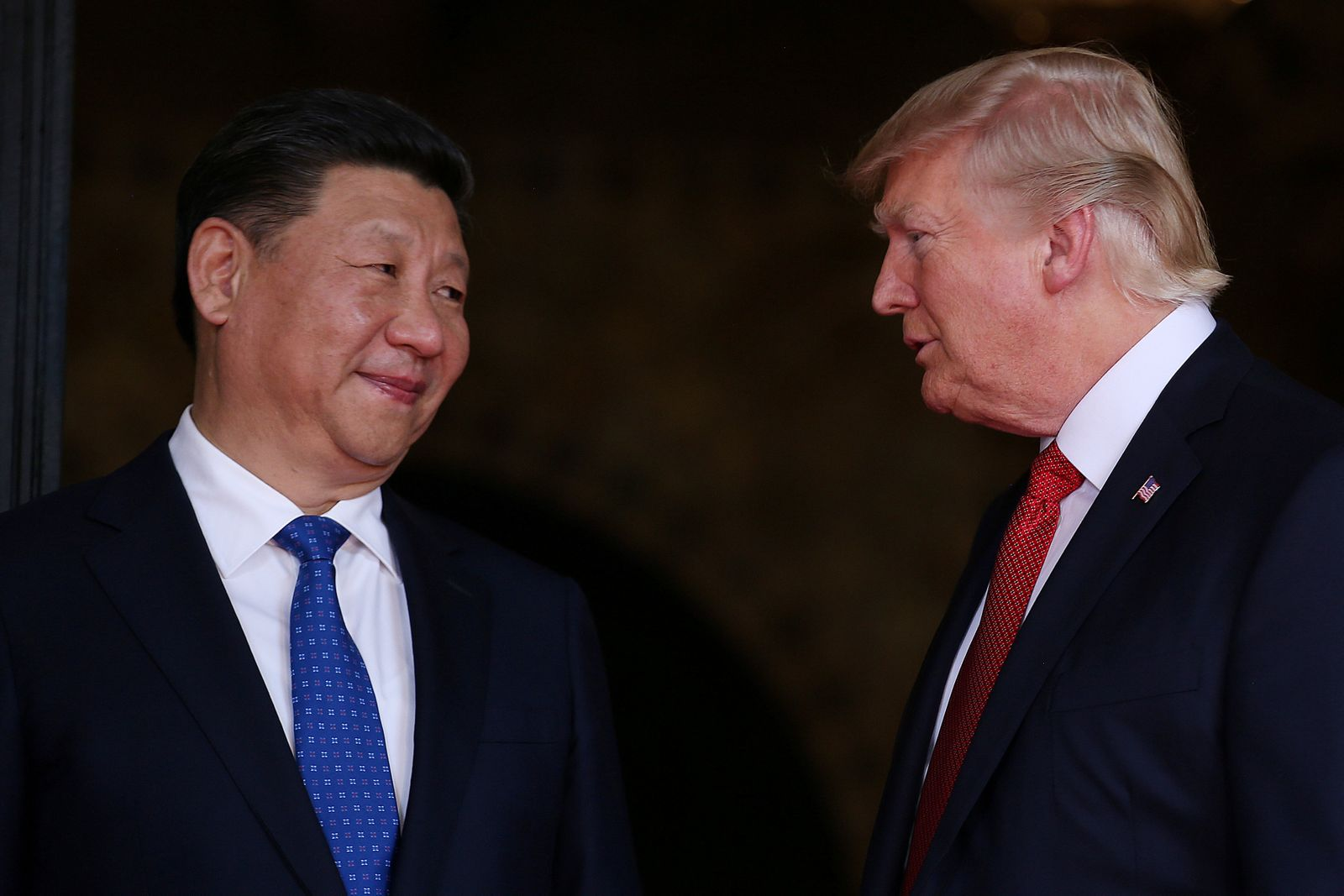 FILE PHOTO: U.S. President Donald Trump welcomes Chinese President Xi Jinping at Mar-a-Lago state in Palm Beach, Florida, U.S.