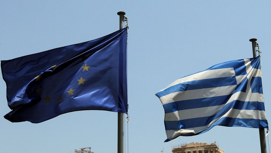 The flags of the EU and Greece in front of the Acropolis. EU officials are realizing that a debt cut may be the only way to rescue Greece.