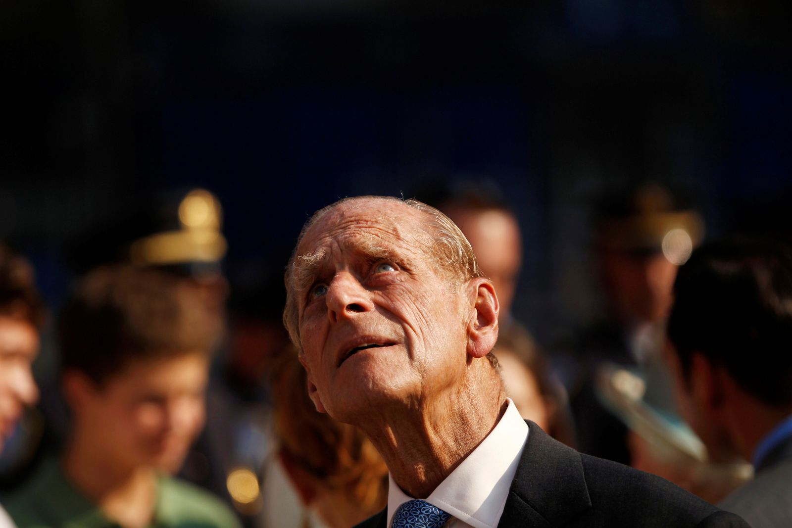 FILE PHOTO: Prince Philip looks up at the site of the September 11, 2001 World Trade Center attack in New York