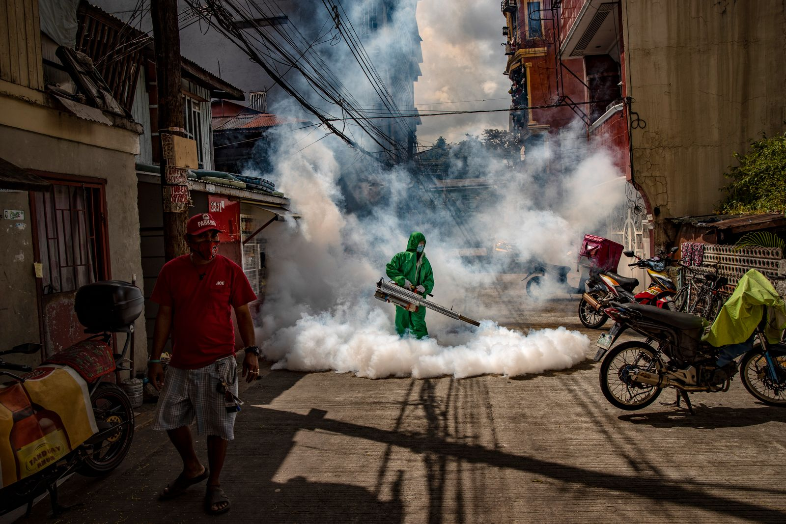 Health Workers Fumigate Manila Slum As Cases Hit Daily Records