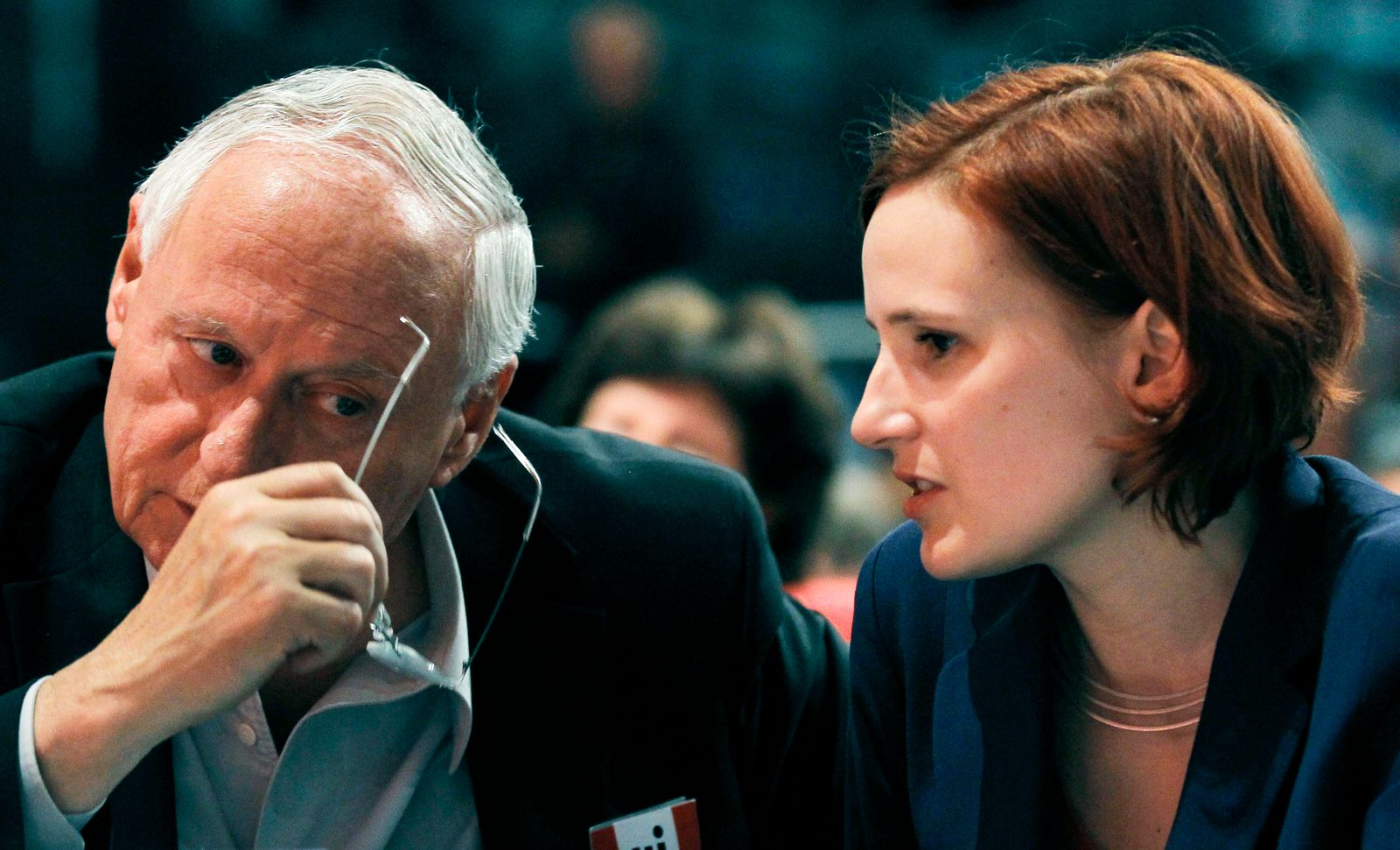 Kipping co-leader of left wing Die Linke party talks with veteran party member Lafontaine at federal party congress in Goettingen