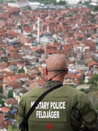 A German KFOR soldier overlooking the city of Prizren.
