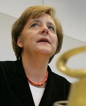 Angela Merkel is Germany's chancellor designate. First, though, she has to hammer out a coalition agreement with the Social Democrats.