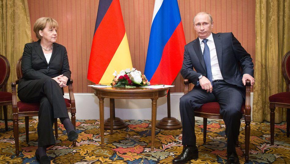 """Merkel und Putin: """"Den zivilgesellschaftlichen Charakter des Dialogs schützen"""""""