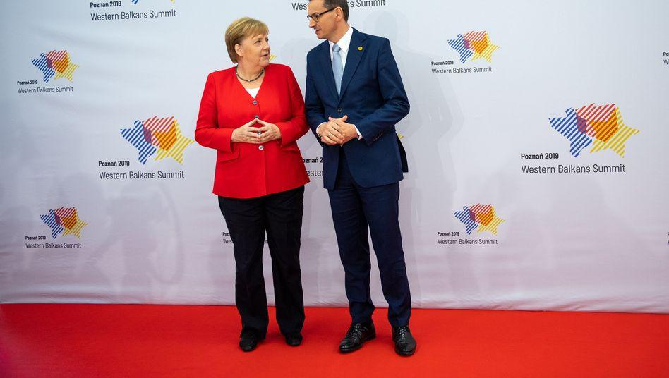 Kanzlerin Merkel, Polens Ministerpräsident Morawiecki: Verfahrene politische Lage