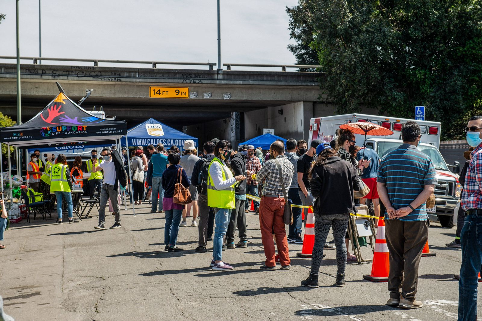 April 2, 2021, Oakland, CA, United States: Hundreds wait in cue for the Janssen COVID-19 Vaccine (Johnson & Johnson) in