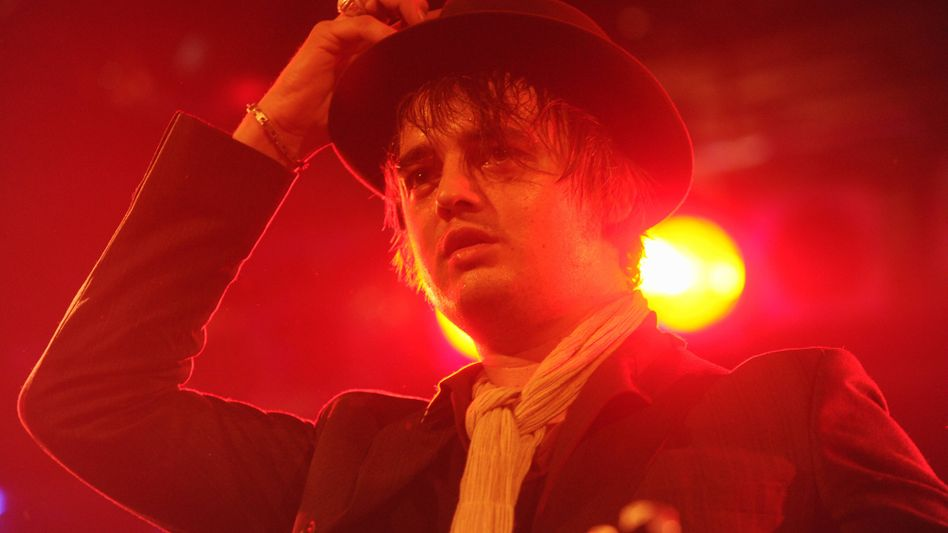Pete Doherty on stage at his concert in Munich Sunday following his gaffe on a live radio broadcast on Saturday.