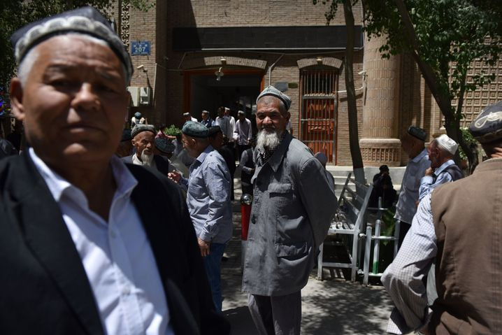 Uighur men leaving a mosque after prayers in Xinjiang in May