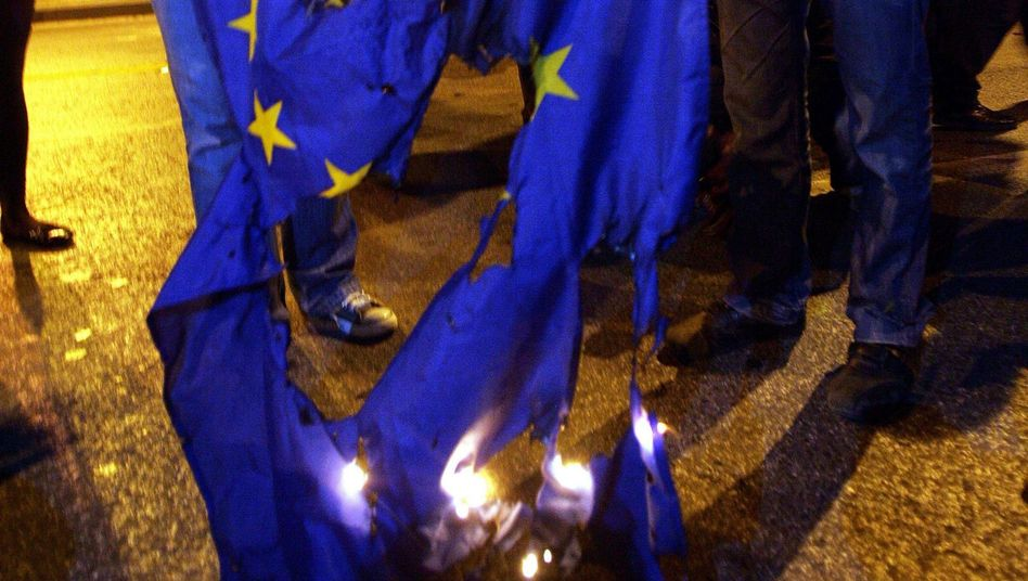 Protestors burn the European flag during a demonstration in Athens (March 2010 photo)