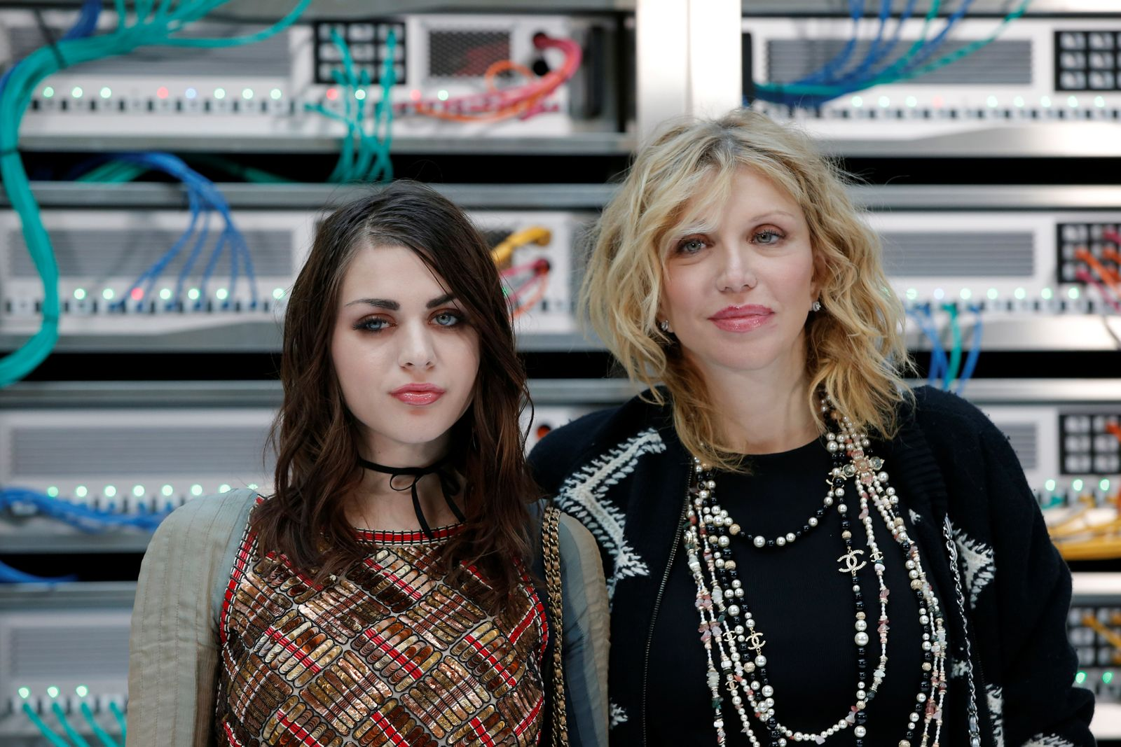 Musician Courtney Love and her daughter and producer Frances Bean Cobain pose during a photocall before the Spring/Summer 2017 women's ready-to-wear collection for fashion house Chanel during Fashion Week in Paris