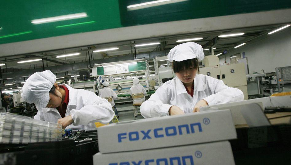 Foxconn-Mitarbeiter in einer Fabrik in der chinesischen Provinz Guangdong