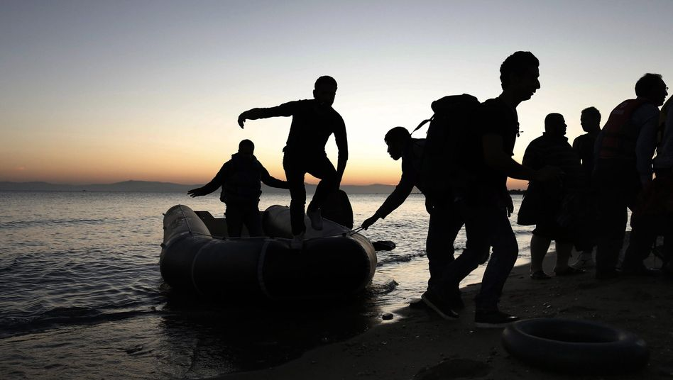 Syrian refugees arrive in a dinghy on the Greek island of Kos on May 6.