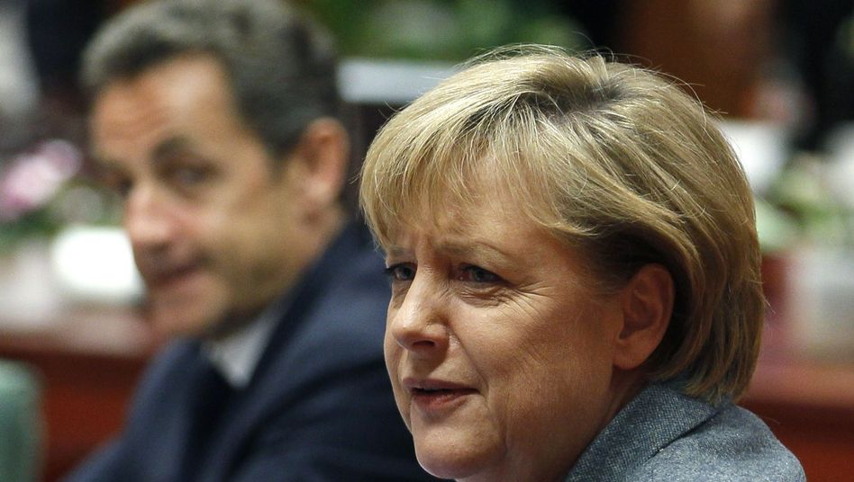 German Chancellor Angela Merkel in Brussels, backed by French President Nicolas Sarkozy (left).