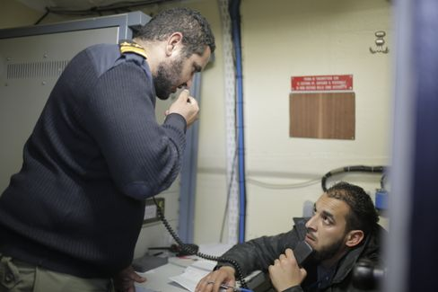 Libyan coast guard officers on the radio aboard the Fezzan: Without aerial surveillance from Europe, they would be flying blind.
