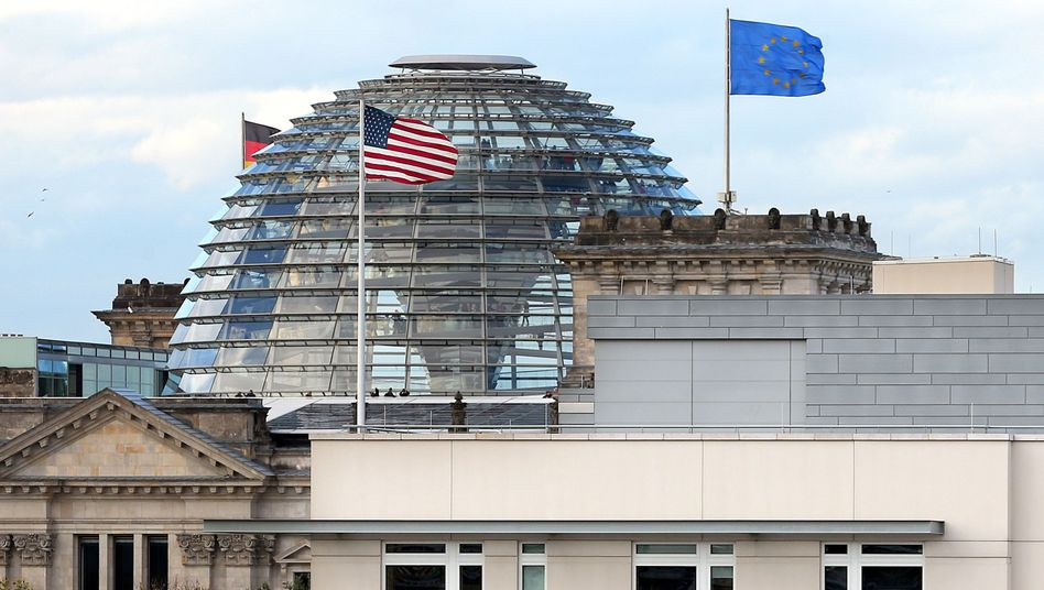 A view of the roof of the US Embassy in Berlin with the dome of the German Reichstag in the background.