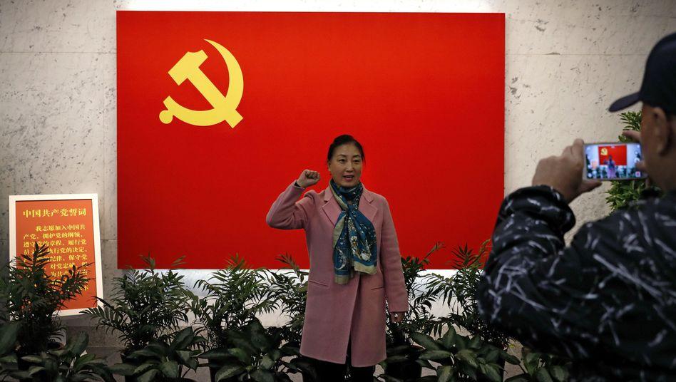 Anhängerin der KP in China