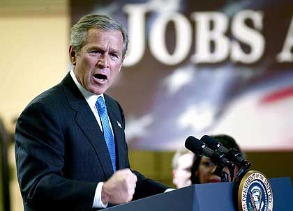 US President George W. Bush at the Timken Company in 2003 promoting his tax cut plan.