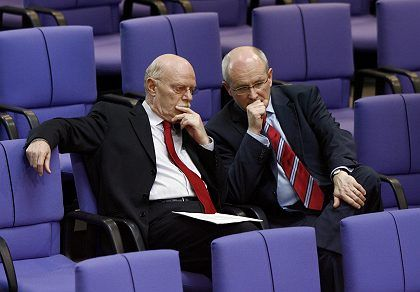 """SPD floor leader Peter Struck discusses the """"Tornado"""" vote in German parliament with his conservative counterpart Volker Kauder. A number of SPD delegates elected not to support the mission."""