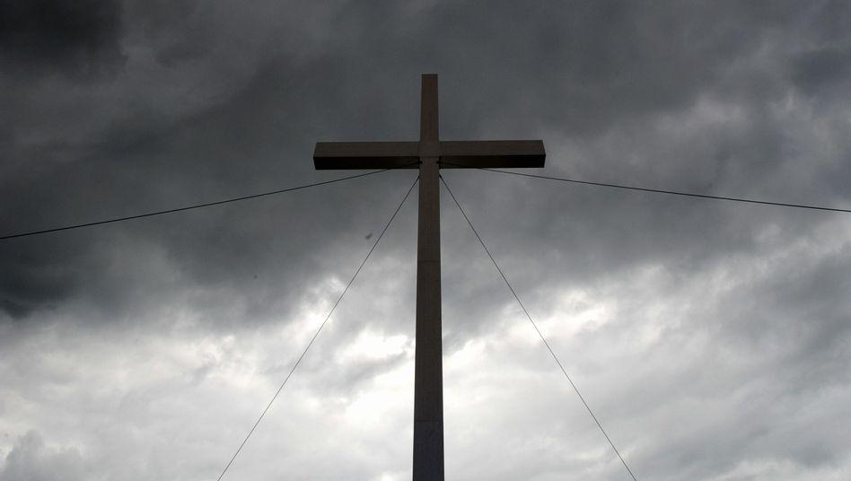 Kreuz auf dem Ökumenischen Kirchentag in München: Beidseitiger Vertrauensverlust