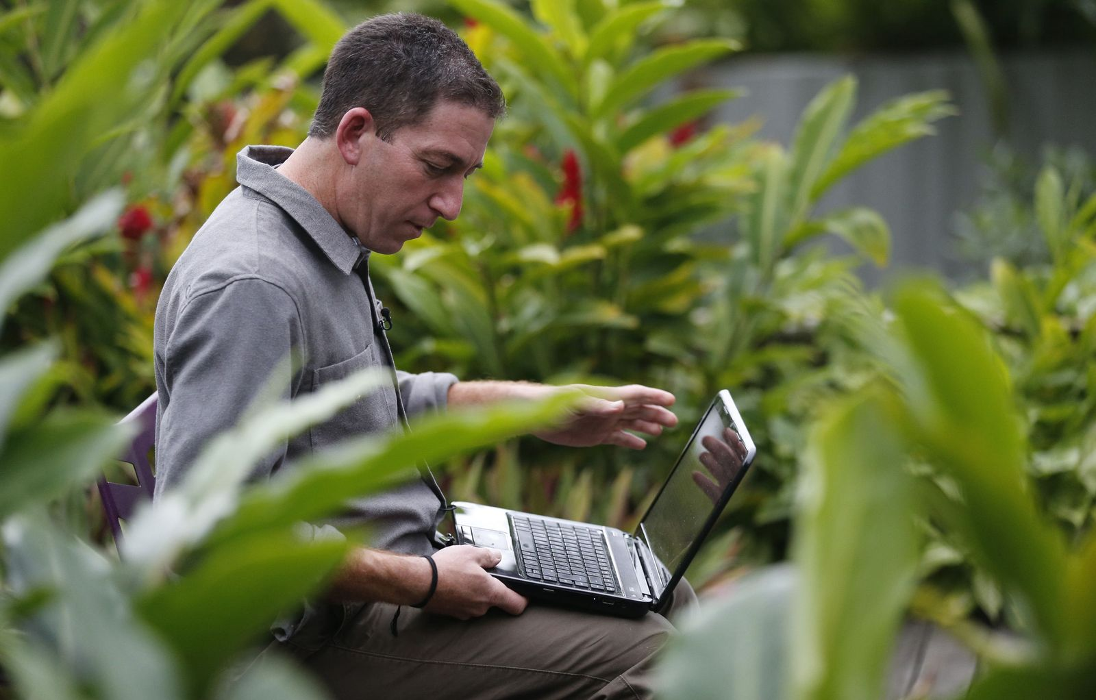 Glenn Greenwald, the blogger and journalist who broke the U.S. NSA surveillance scandal, uses his laptop before an exclusive interview with Reuters in Rio de Janeiro