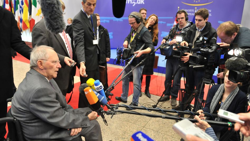 German Finance Minister Schäuble with journalists at the euro-zone meeting on Tuesday.