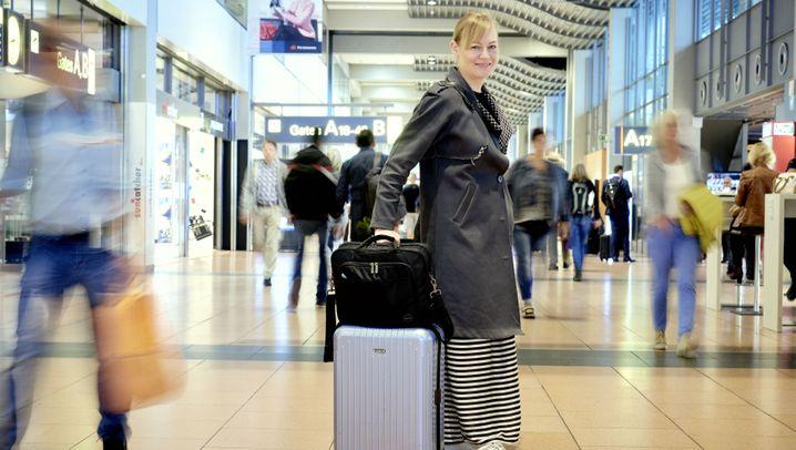 Tipps und Tricks: Geschäftsreisende packen aus - ihre Koffer
