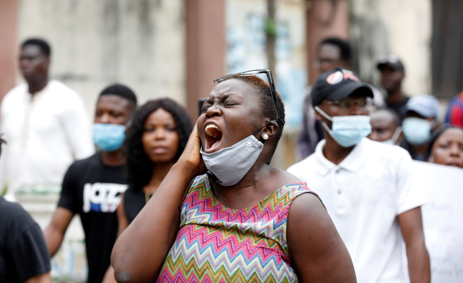 Nigerians take part in a protest against alleged violence, extortion and harassment from Nigeria's Special Anti-Robbery Squad (SARS), in Lagos
