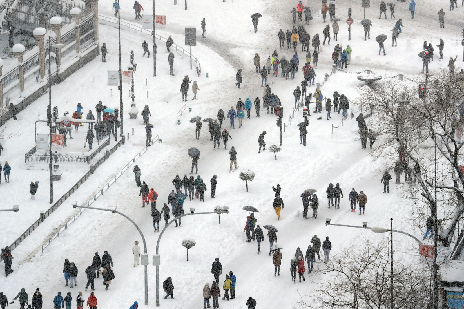 People are seen from the rooftop of the Circulo de Bellas Artes cultural center during a heavy snowfall in Madrid