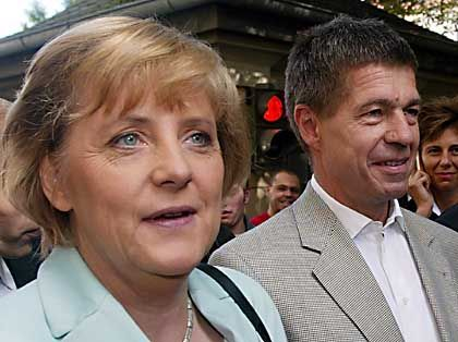 Merkel and her husband go to vote on Sept. 18.