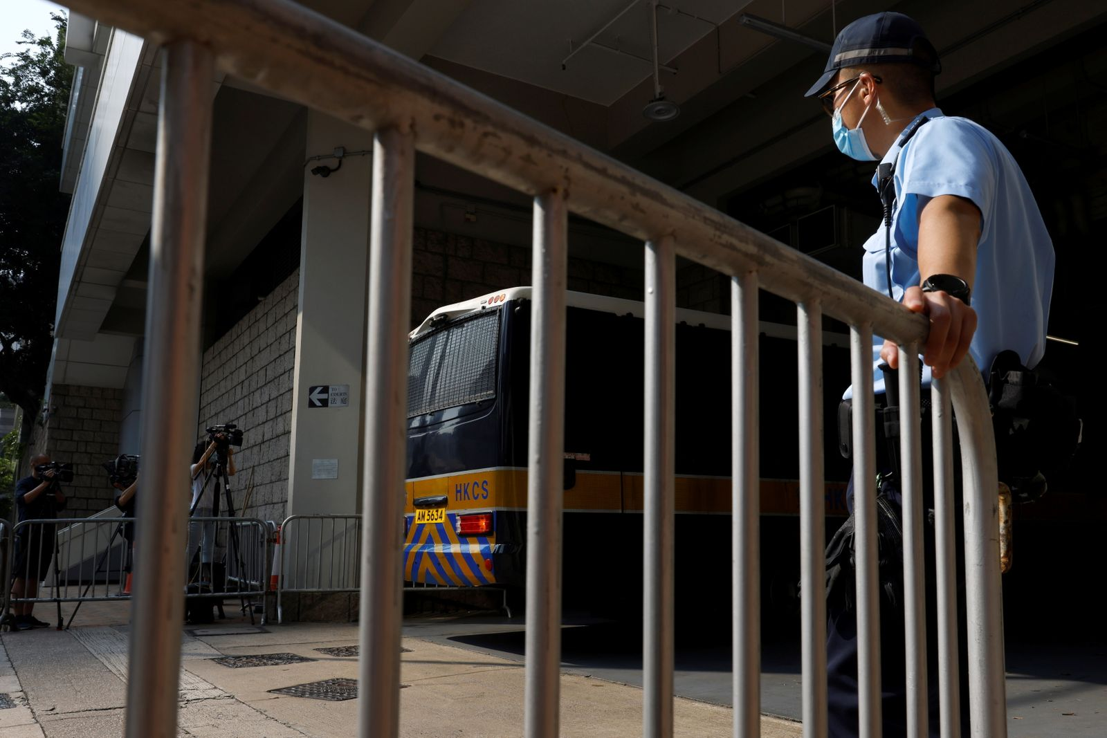 A prison van carrying Tong Ying-kit, the first person charged under the new national security law, arrives at High Court for a hearing, in Hong Kong