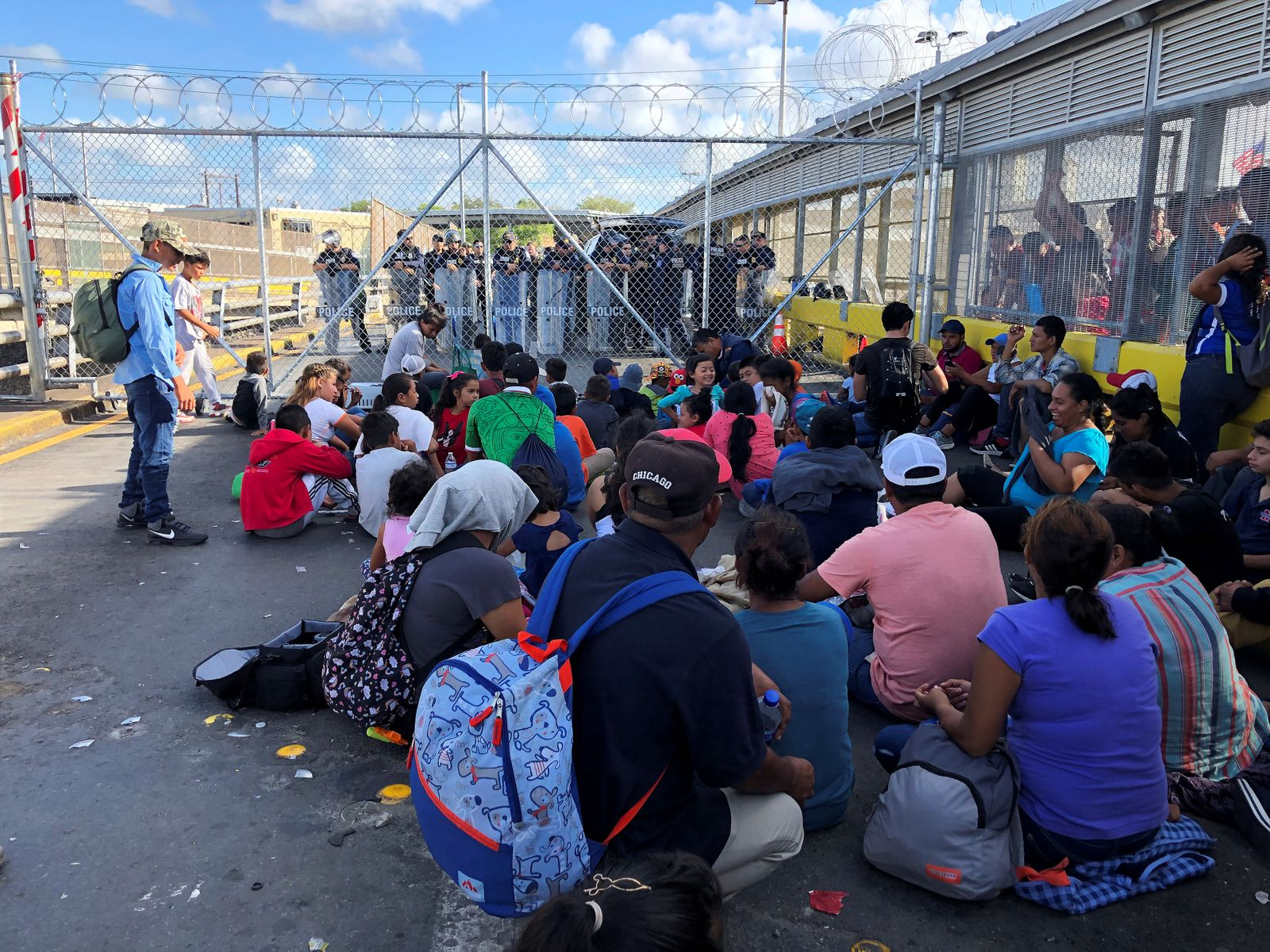 Migrants, returned to Mexico to await their U.S. asylum hearing, block the Puerta Mexico international border crossing bridge to demand quickness in their asylum process in Matamoros