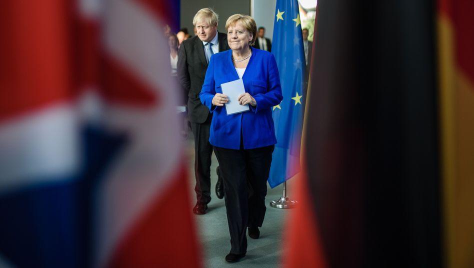 Angela Merkel, Boris Johnson: Kein Grund zur Panik - vorerst