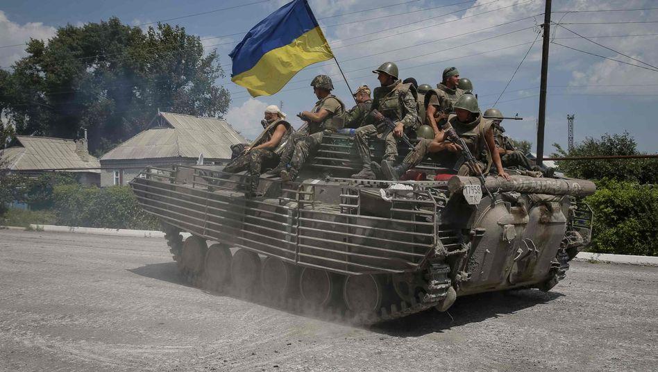 Ukrainische Soldaten in der Ostukraine: Offenbar Blockade des Flughafens in Luhansk durchbrochen