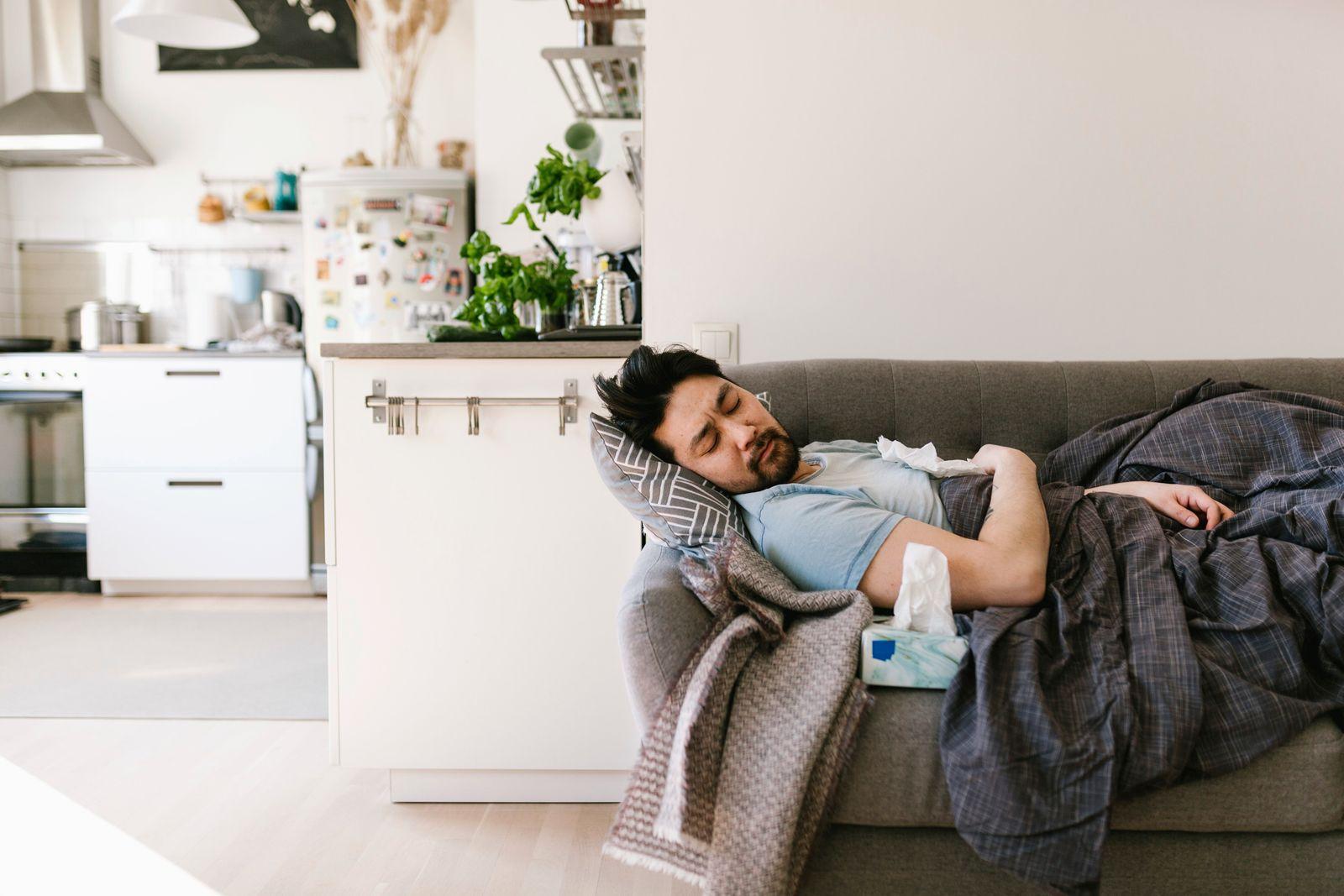 Asian man sick at home and sleeping