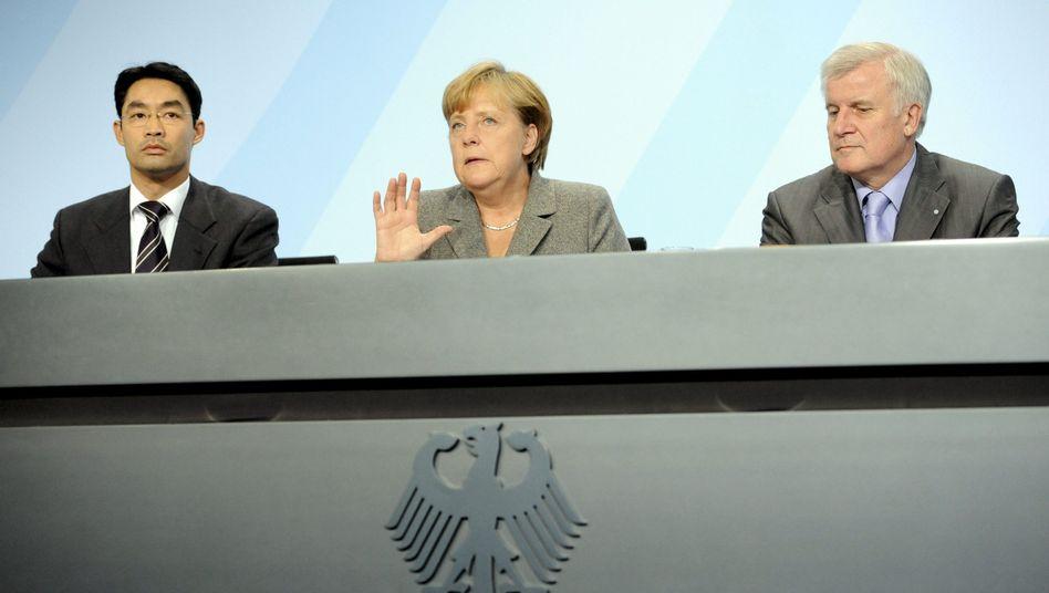 Rösler (l.), Merkel, Seehofer: Gold sieht anders aus