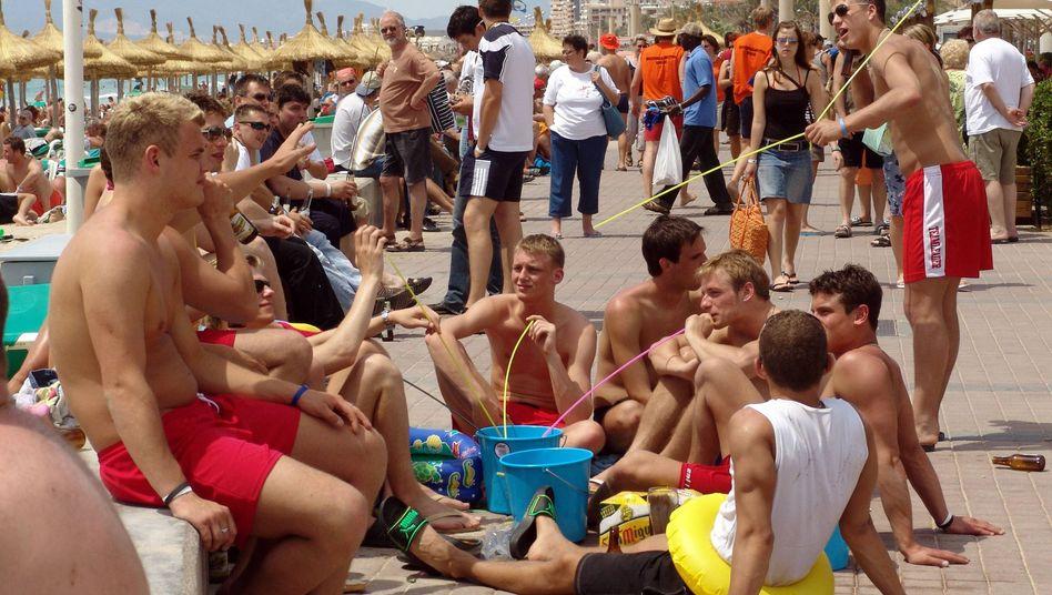 German tourists slurping Sangria on the Playa de Palma seafront.