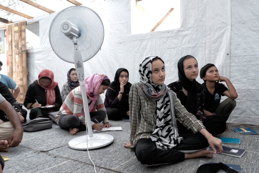 Refugee women learning English in the camp's school