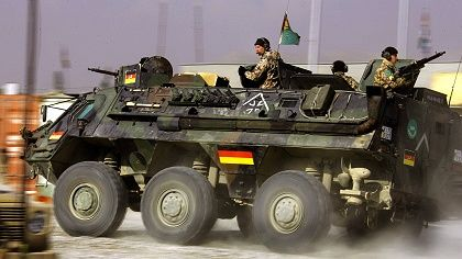 A German armored personnel carrier driving through the Afghan capital of Kabul.