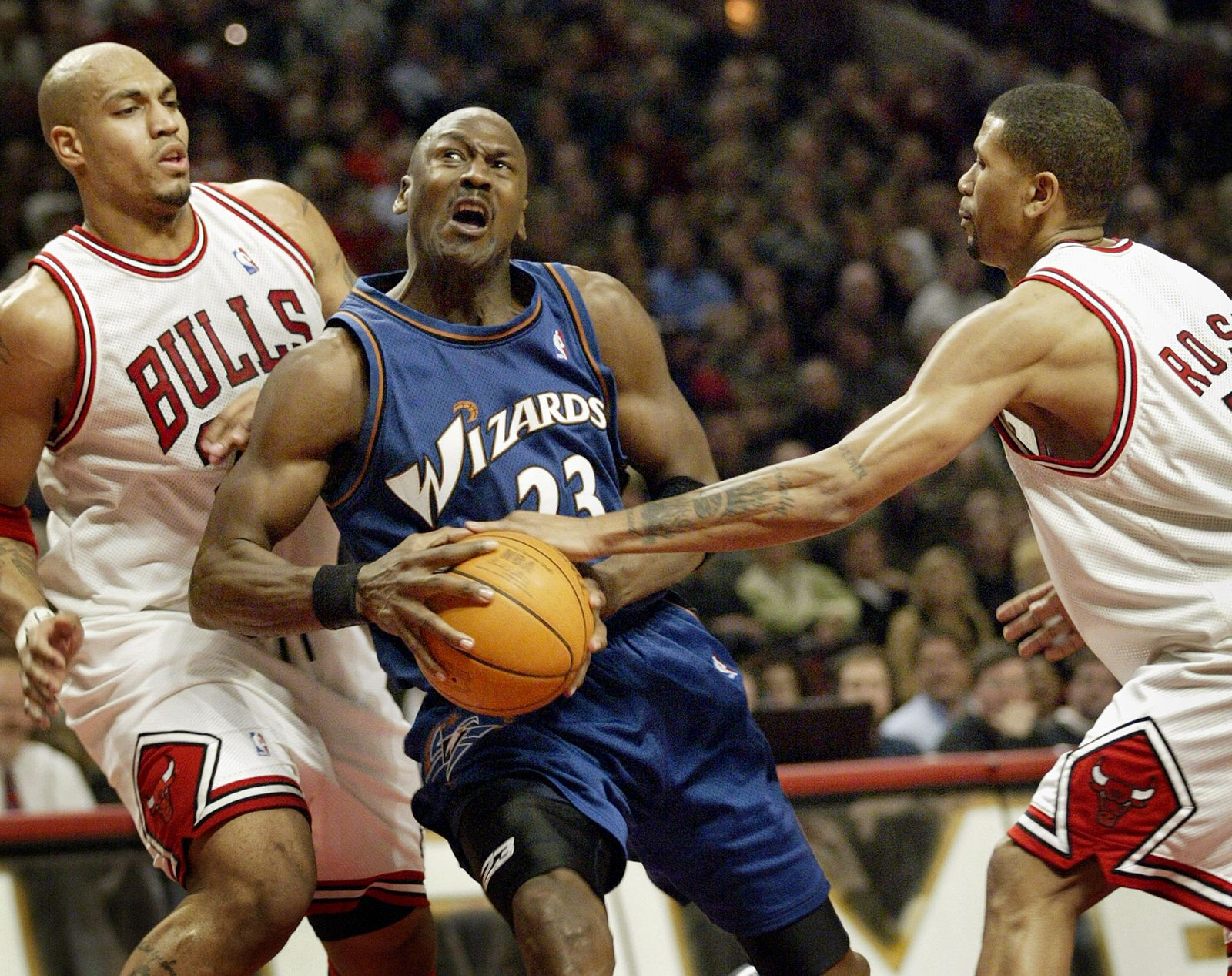 WIZARDS MICHAEL JORDAN GETS STRIPPED OF BALL WHILE GOING FOR A SHOT.