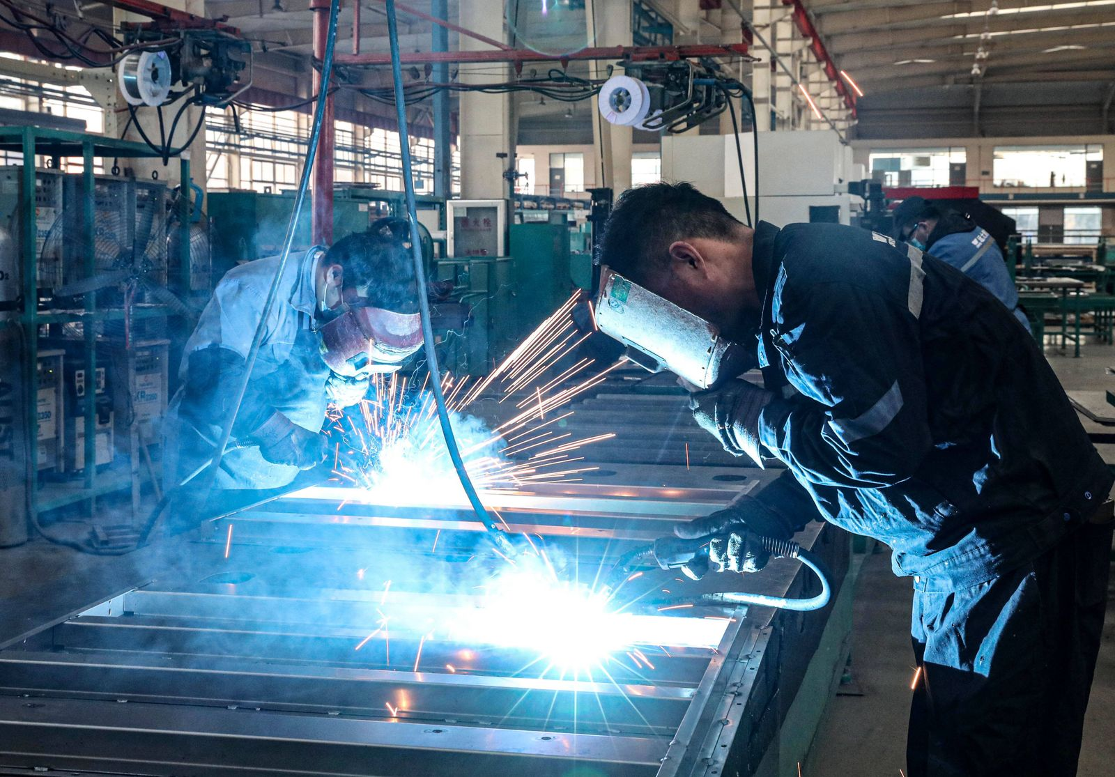 SHENYANG, CHINA - DECEMBER 22: Employees work on the production line of escalator and elevator for export at a factory