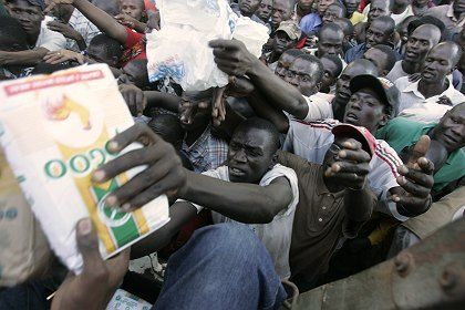 Kenyans scramble for food as the Kenyan Red Cross distribute supplies in the Mathare slum, in Nairobi on Sunday.
