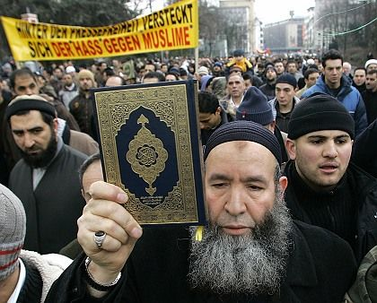 Muslims protest in Dusseldorf against the Danish Muhammad cartoons in this Feb. 2006 photo. The Interior Ministry has warned that exclusion of Muslims from mainstream German society is leading to radicalization.