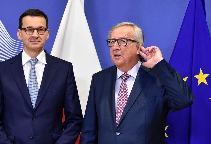 Polens Regierungschef Morawiecki, EU-Kommissionspräsident Jean-Claude Juncker