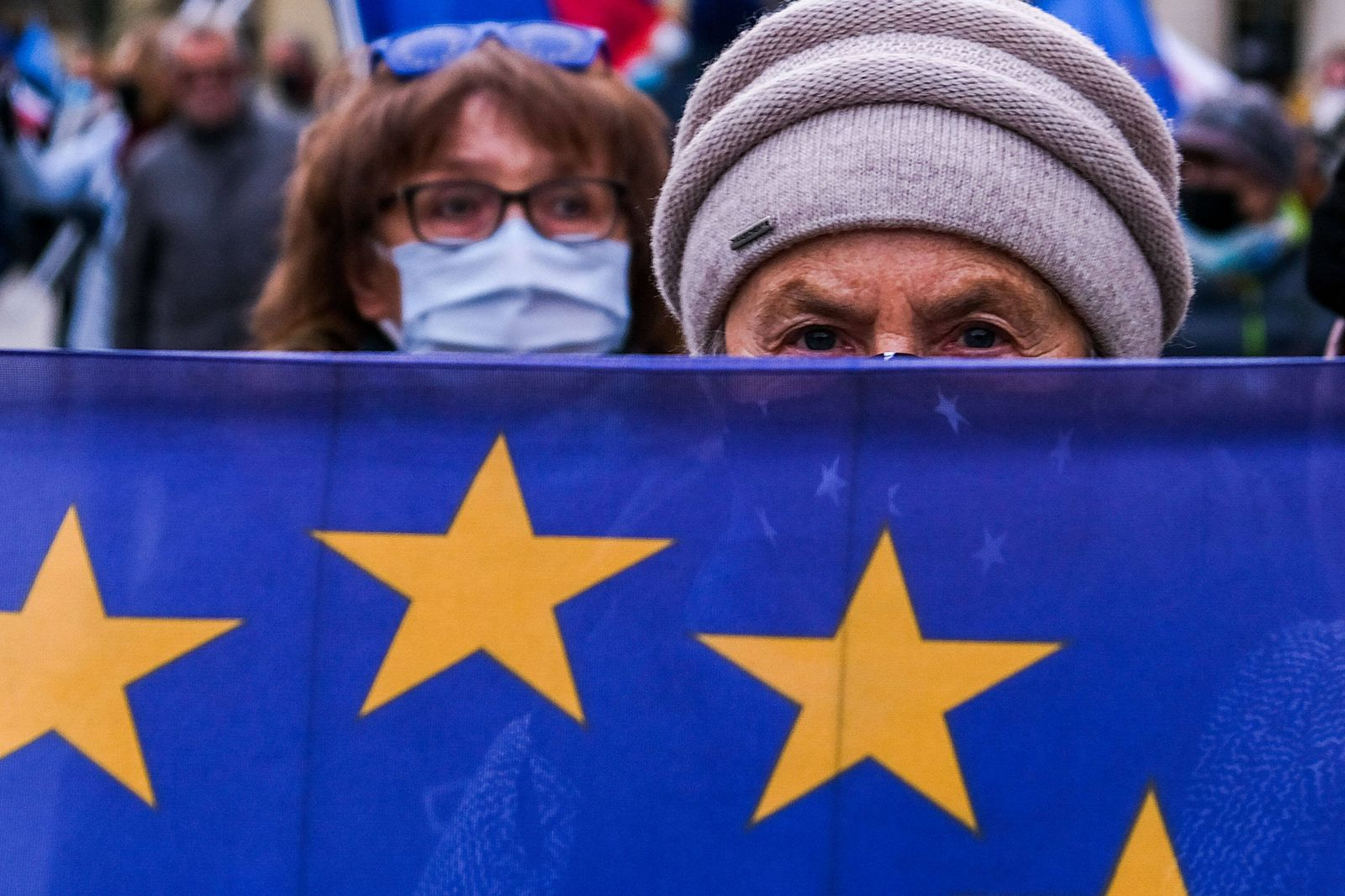 November 22, 2020, Krakow, Poland: An old woman holding the European Union flag during the demonstration..People protes