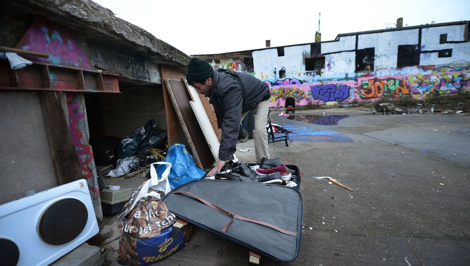 Forty-five-year-old Romanian immigrant Kalin packs his suitcase with objects he has found and wants to sell at a flea market in Frankfurt.
